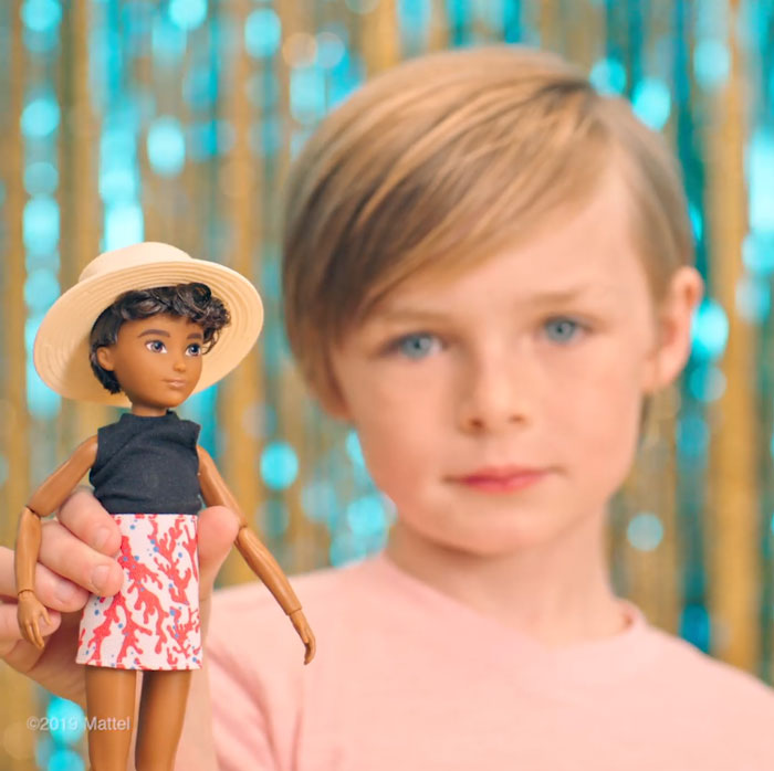 Fair-skinned Boy Holding a Doll with Brunette Wavy Hair