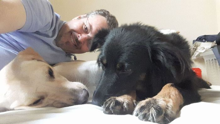 Father João Paulo Araujo Gomes Taking a Selfie with Two Stray Dogs