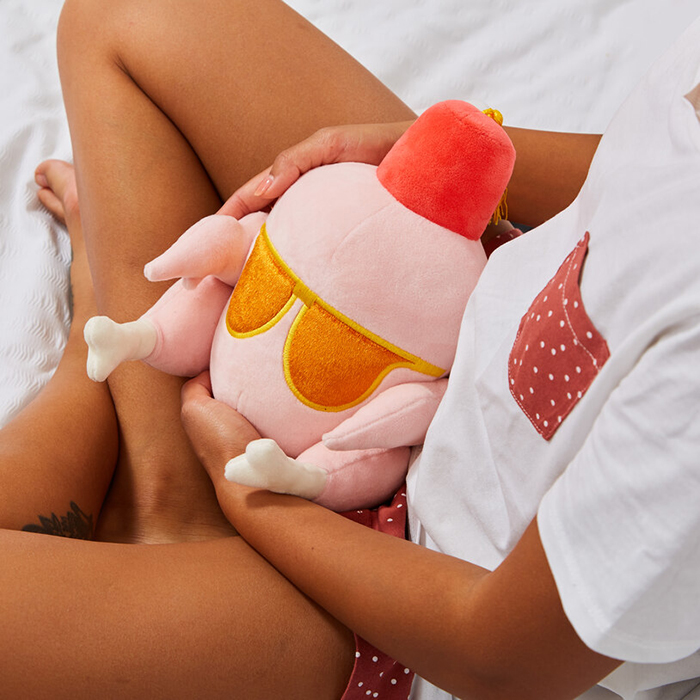 model cradling the friends heatable turkey plush