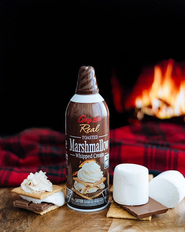 Gay Lea Toasted Marshmallow Whipped Cream with a Fireplace Background