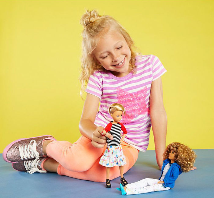 Girl Playing with Dolls on Floor