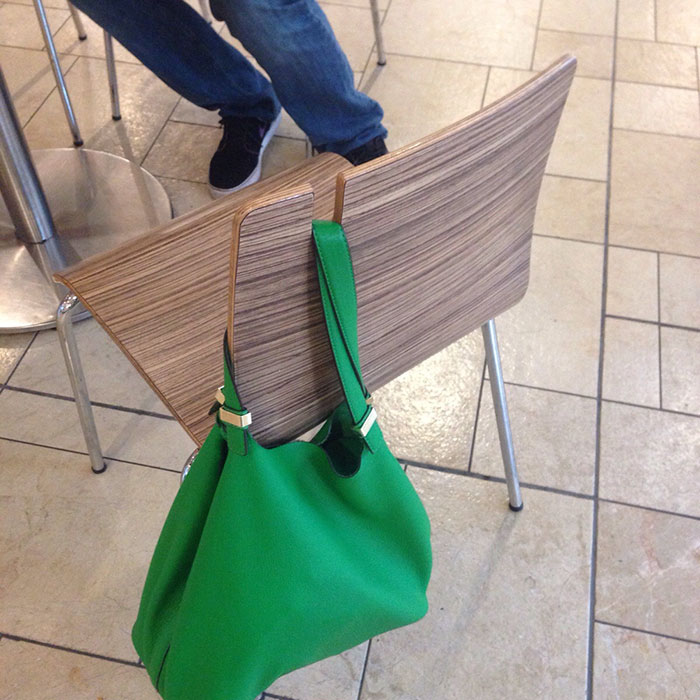 Green Shoulder Bag Hung on a Chair's Bag Holder