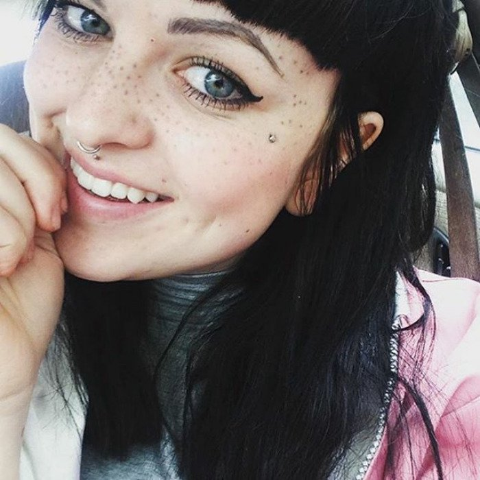 Lady with Black Hair, Nose Ring, and Freckle Tattoos on Face