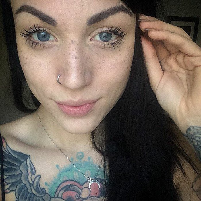 Lady with Long Black Hair and Freckle Tattoos on Face