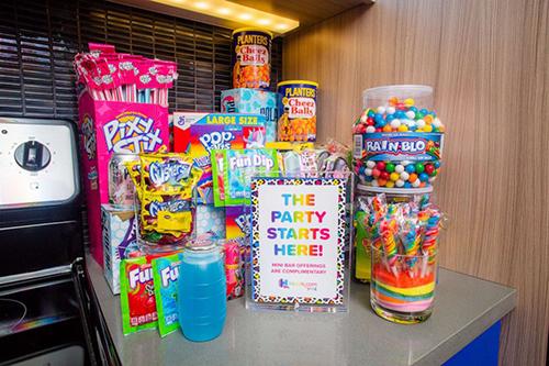 Lisa Frank-Themed hotel room mini bar snacks