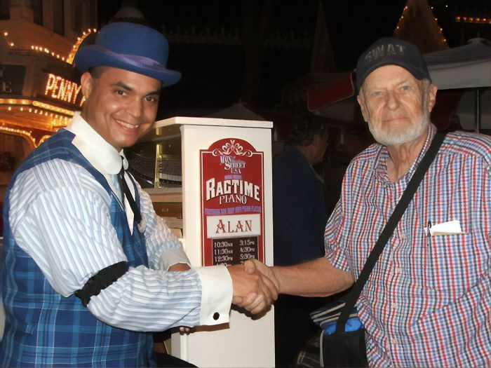 A Disney Employee Shakes Hands with Disneyland's first ever customer