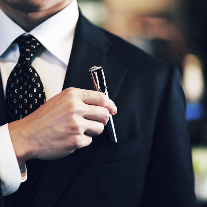 Man Keeping Starbucks Touch The Pen into Suit Pocket