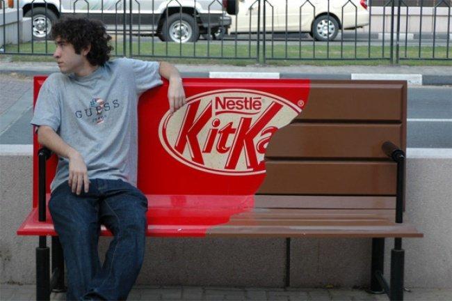 Man Sitting on Kitkat Bench
