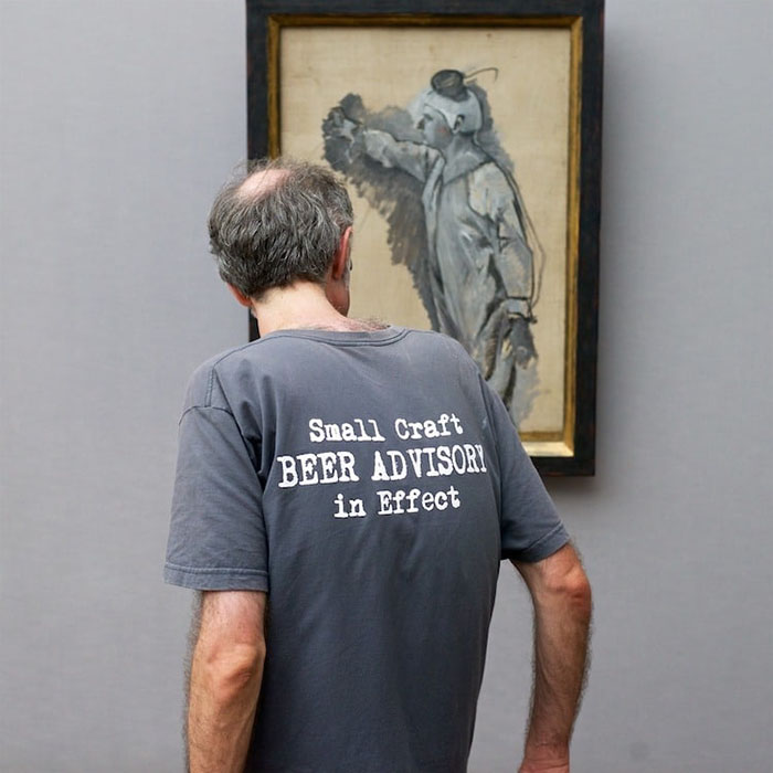 Man in Gray Shirt Matching Painting