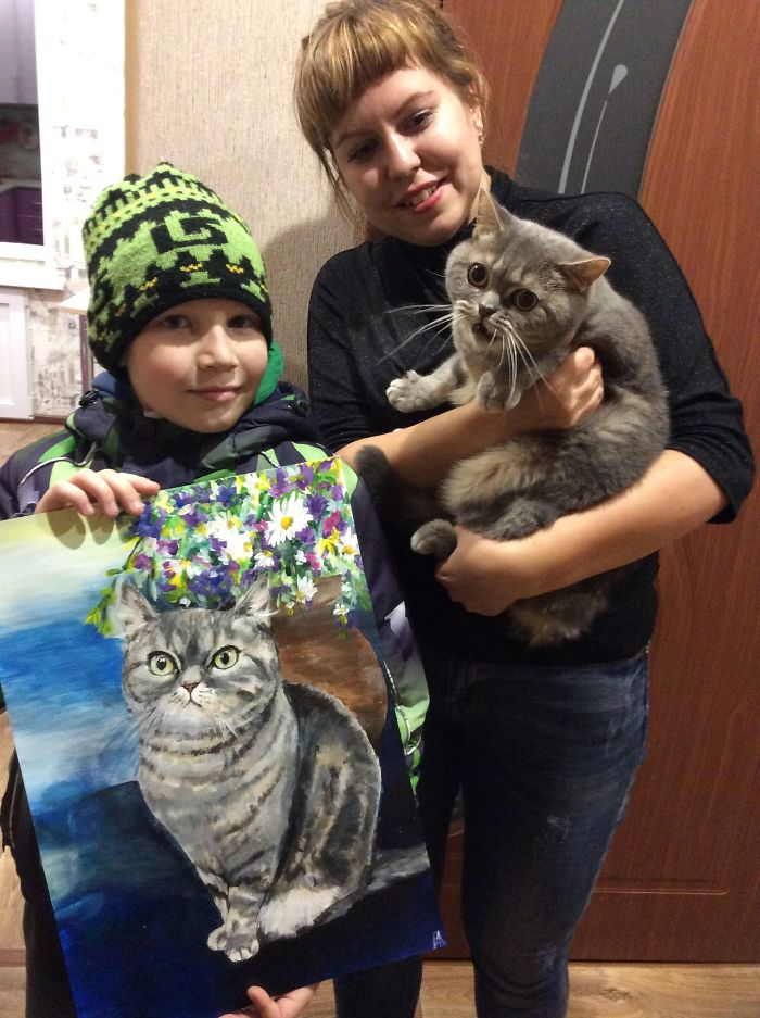 Pavel Abramov Holding His Cat Painting Beside a Lady Carrying Her Pet Cat