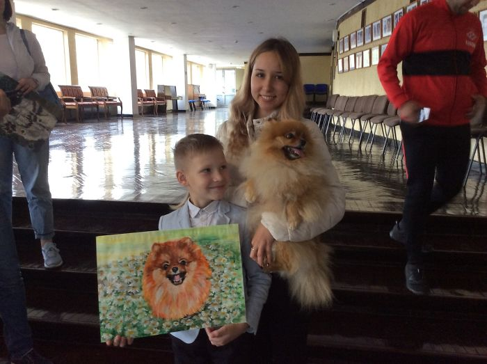 Pavel Abramov Holding His Dog Painting Beside a Lady Carrying Her Pet Dog