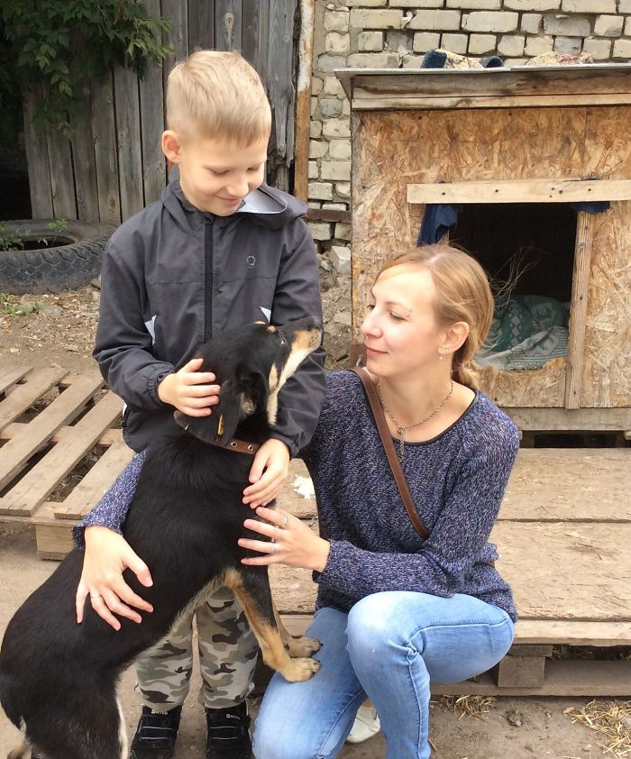 Pavel Abramov with Mother Ekaterina Bolshakova and a Black Dog