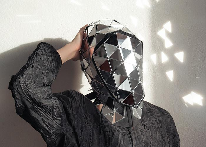 Person Wearing a Reflective Mirror Helmet by Ewa Nowak 2