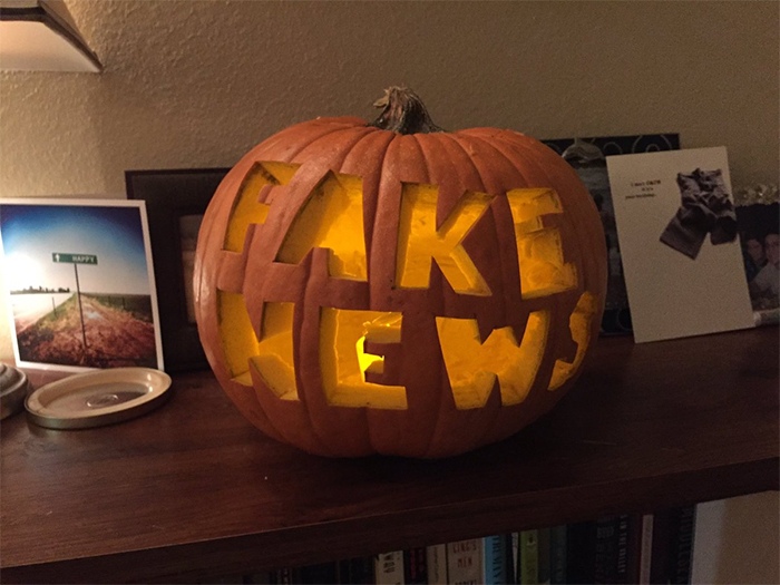 Pumpkin with Fake News Carving