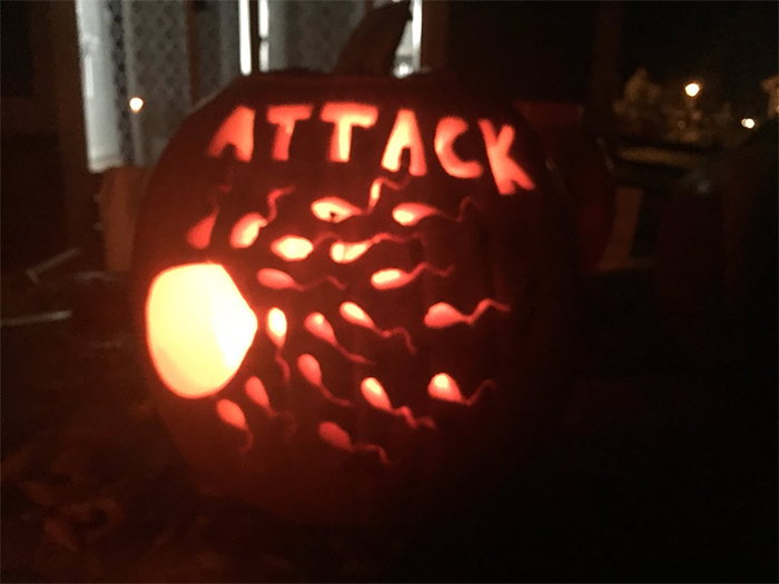 Pumpkin with Sperms Attacking an Egg Carving