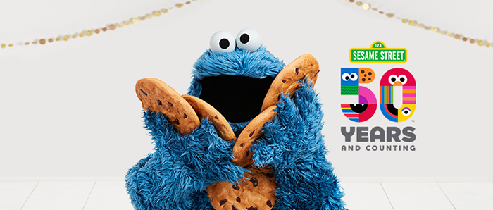 Sesame Street 50th Anniversary Banner Featuring Cookie Monster Holding Cookies