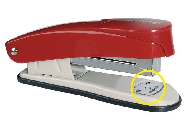 Stapling Plate of a Red Stapler Indicated by a Yellow Circle