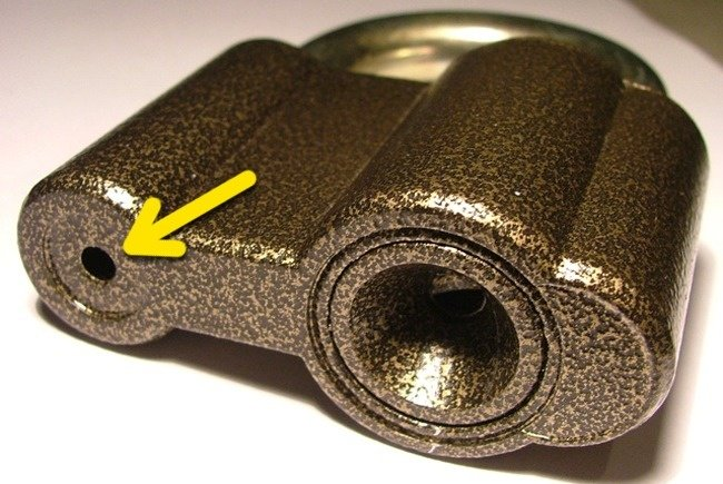 Yellow Arrow Pointing to the Hole on the Bottom of a Padlock