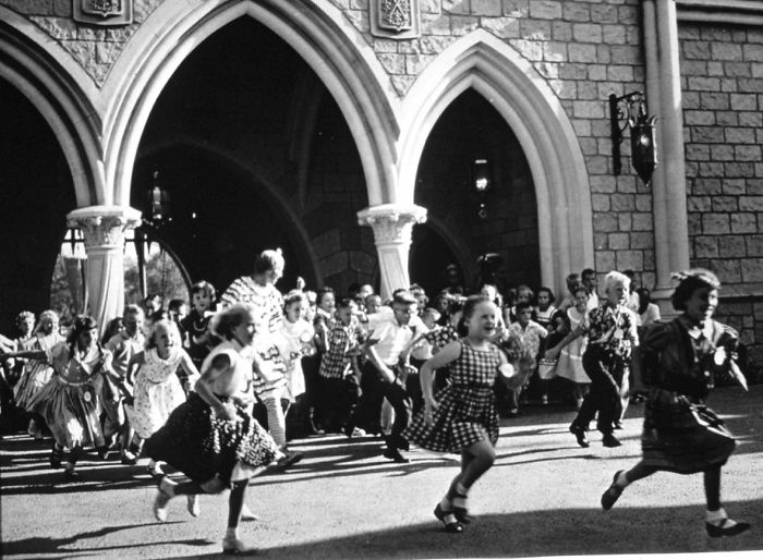 Children run inside Disneyland for the first time