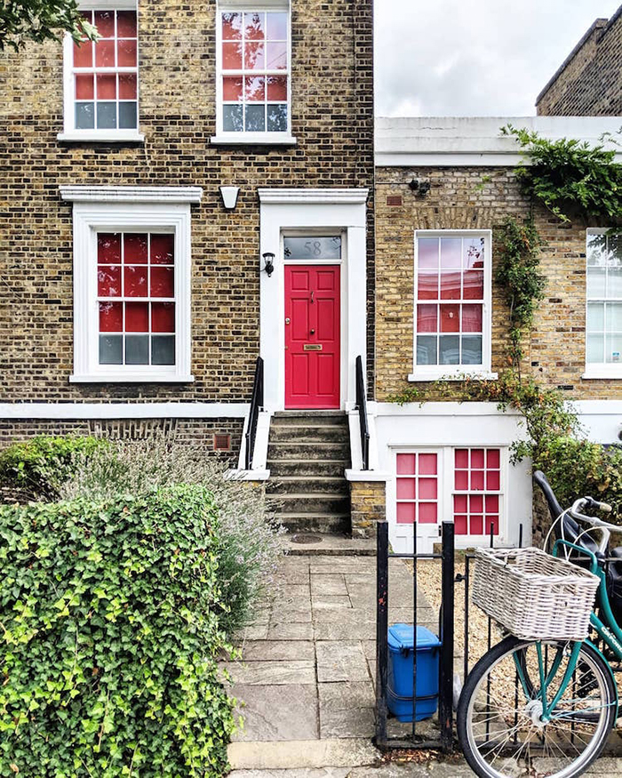 colorful front doors in shades of red