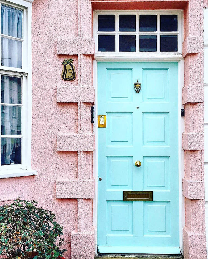 colorful front doors pastel blue against pink