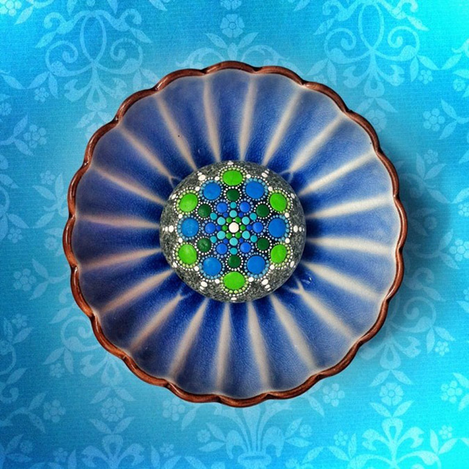 mandala stones placed in decorative plate