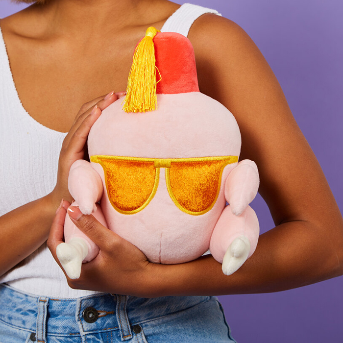 model holding the friends heatable turkey plush