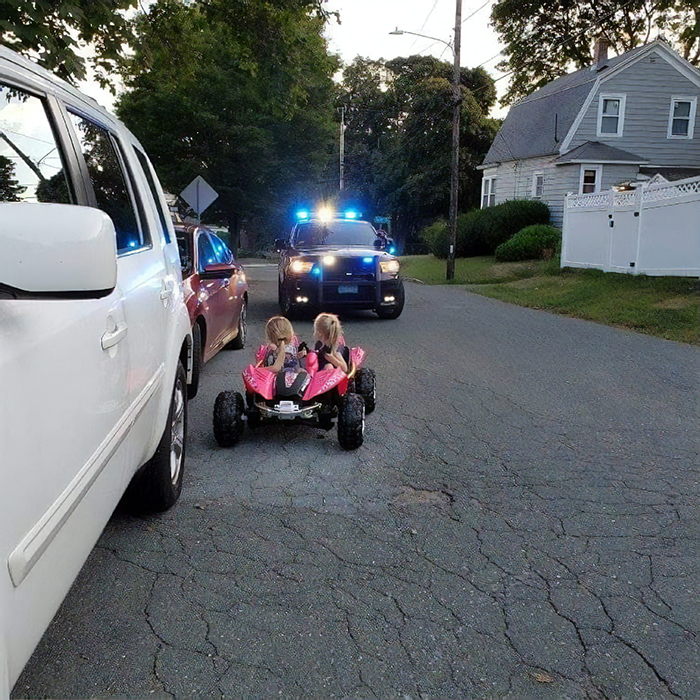 the sisters driving a pink toy car