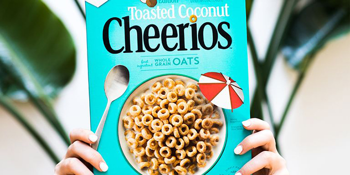 toasted coconut cheerios held up by two hands