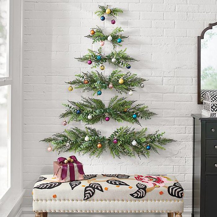 wall-mounted christmas tree with hanging decors