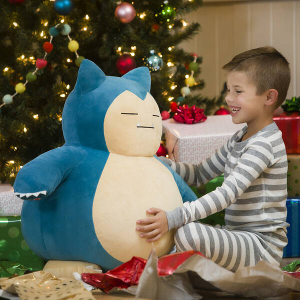 A little boy getting Build-A-Bear's Snorlax