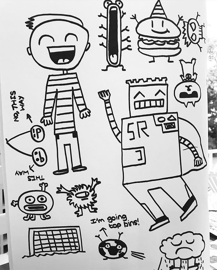 Doodle of a Boy with a Robot, a Buger, Aliens, and Smileys