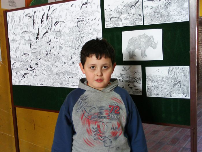 Eight-year-old Dusan Krtolica with His Drawings