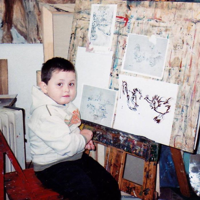 Four-year-old Dusan Krtolica with His Drawings