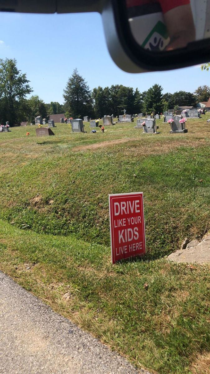 Funny Threatening Signs cemetery