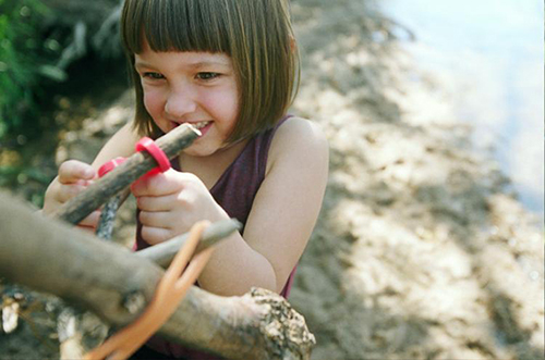Girl Using Starfish Red to Connect Two Sticks