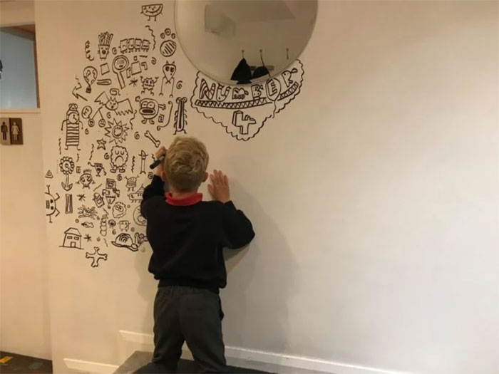 Joe Whale Doodling on the Center Part of a Wall