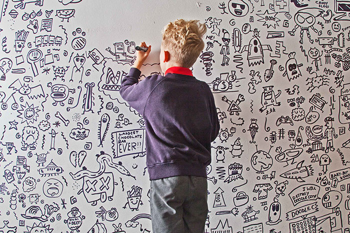 Joe Whale Drawing More Doodles on the Wall