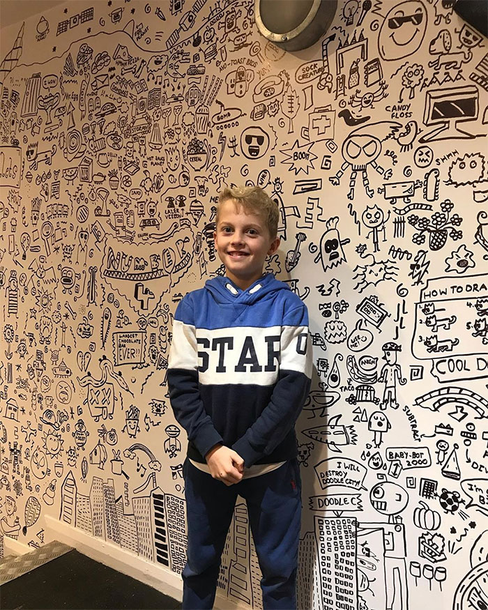 Joe Whale Posing with His Wall Doodles