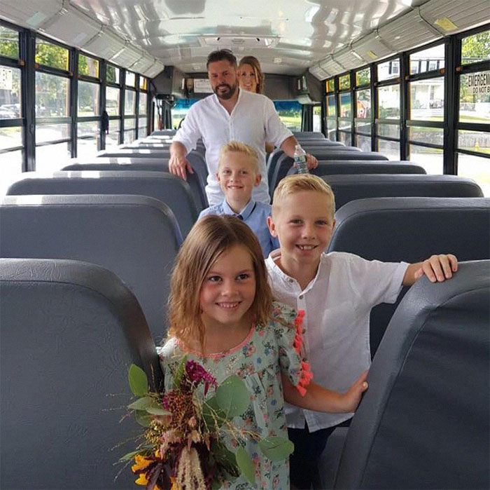 Joe Whale and His Family Inside a Bus