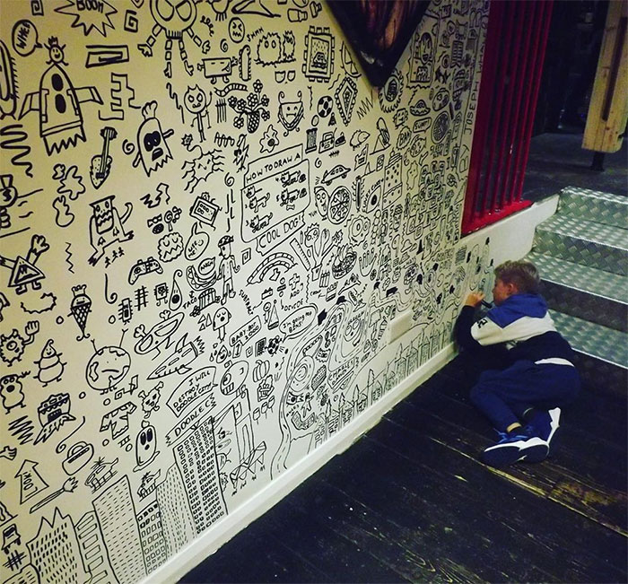 Joe Whale on the Verge of Completing His Wall Doodles 2