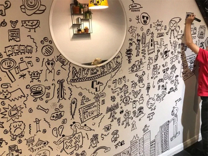 Joe Whale on the Verge of Completing His Wall Doodles
