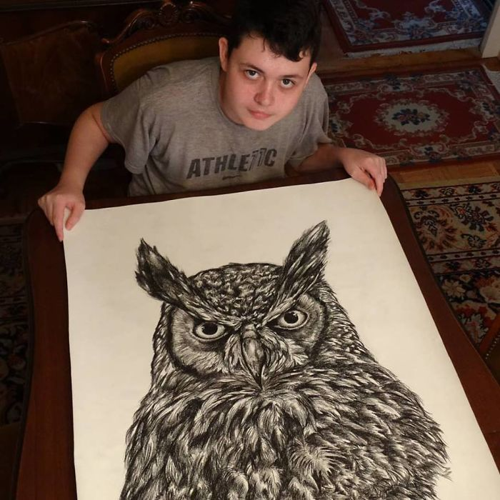 Krtolica Showing His Drawing of an Owl