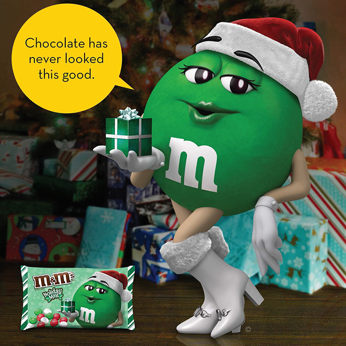 M&M's Ms. Green Holding a Small Gift Box