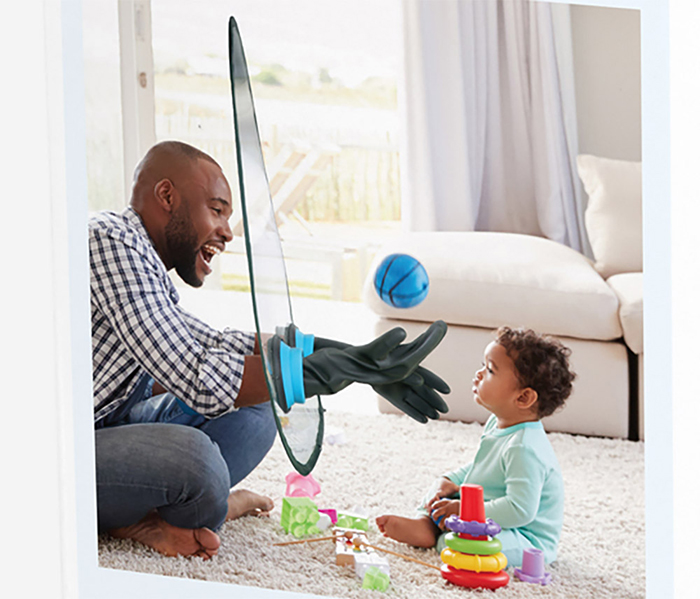 Man Using a Shield while Playing with Baby