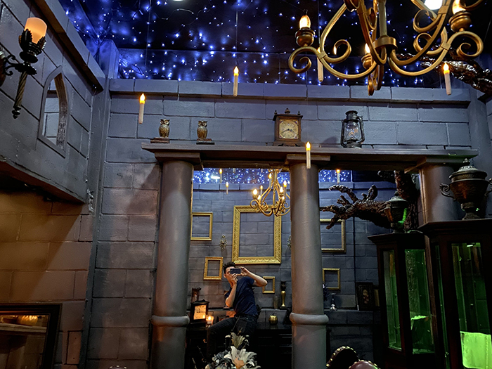 Owner Brian Thompson Taking a Photo of His Bedroom Inspired by Harry Potter