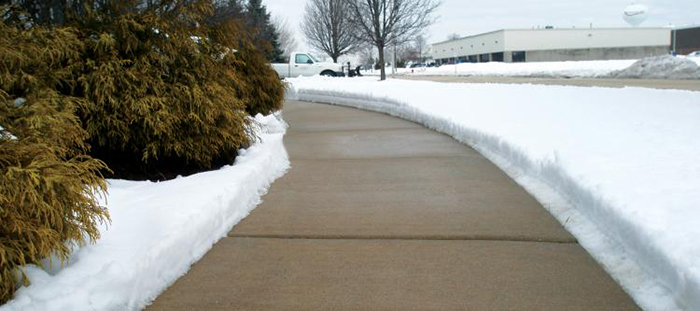 Sidewalk Treated with Snow and Ice Preemptive Treatment Solution