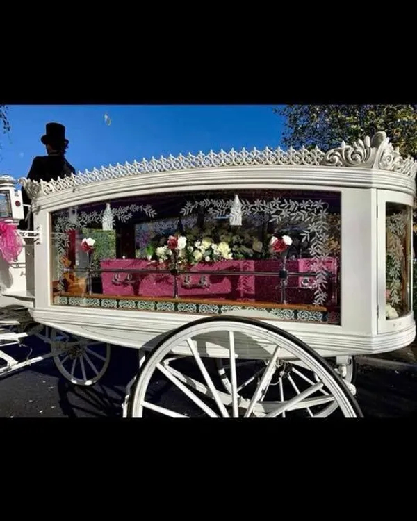 White Hearse with a Pink Glittery Casket