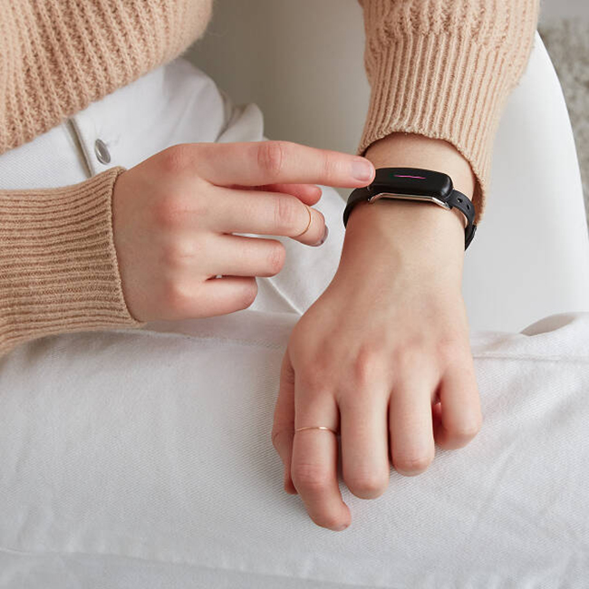 Woman's Hand Tapping Her Vibrating Bracelet
