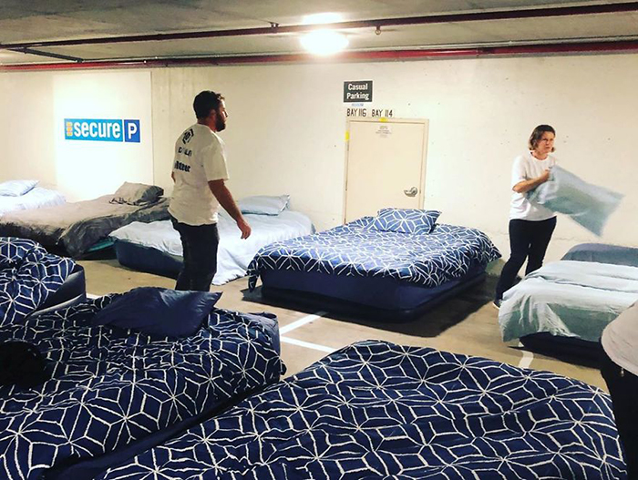 beddown sets up bed on empty parking lot for homeless